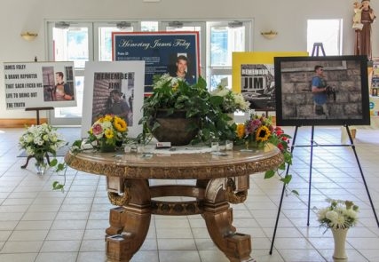 Photos and flowers were on display in honor of James Foley on Sunday (Aug. 24) at Our Lady of the Holy Rosary in Rochester, N.H. Photo by Shawn St. Hilaire / Democrat Photo