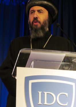 Bishop Angaleos, General Bishop of the Coptic Orthodox Church in the United Kingdom, speaks at the first inaugural summit of In Defense of Christians. The three-day meeting focused on the plight of Christians in the Middle East. Angaleos's church -- the Coptic Church -- is the largest in the Middle East, and its adherents are concentrated in Egypt, where he was born. Religion News Service photo by Lauren Markoe