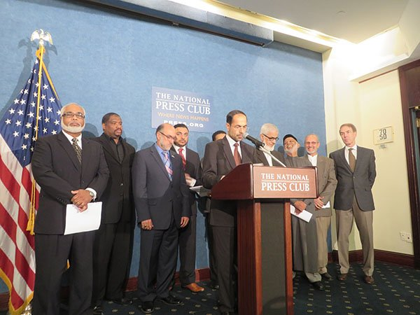 Nihad Awad, center, executive director of the Council of American-Islamic Relations, and more than 10 Muslim-American leaders Wednesday (Sept. 24) endorse a letter written by more than 100 Islamic scholars that denounces ISIS by relying on sacred Muslims texts. Religion News Service photo by Lauren Markoe