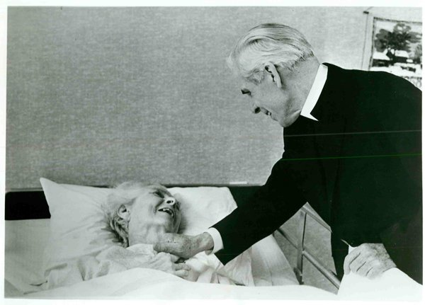 Then Bishop Fulton J. Sheen offers a word of encouragement to a resident at the Lakeshore Nursing home in Rochester, N.Y. Religion News Service file photo