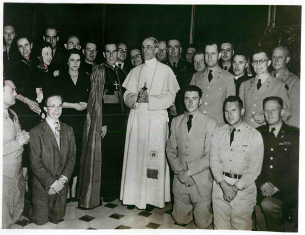 The most Rev. Fulton J. Sheen, then newly consecrated titular Bishop of Caesariana and auxiliary Bishop of New York, center left, appears with Pope Pius XII and a group of Americans after being received in special audience by the Pontiff in 1951. Religion News Service file photo