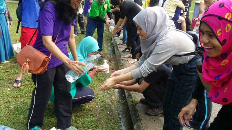 Muslim participants perform a cleansing ritual to be carried out after coming into contact with a dog. Photo courtesy of I Want To Touch A Dog organizers