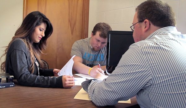 The Rev. Zach Szmara, far right, pastor of The Bridge Community Church in Logansport, Ind., started a legal clinic in February and has assisted more than 100 clients. Photo courtesy of Chip Bos, The Wesleyan Church