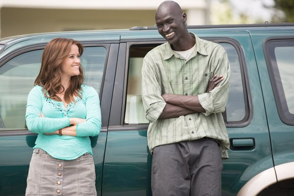 "Actors Reese Witherspoon and Jeremiah Ger Duany in a scene from ""Good Lie."" Photo courtesy of Alcon Entertainment"