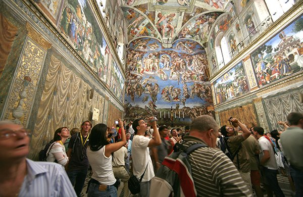 Visitors view the Sistine Chapel in Rome. Photo courtesy of Vatican Museums