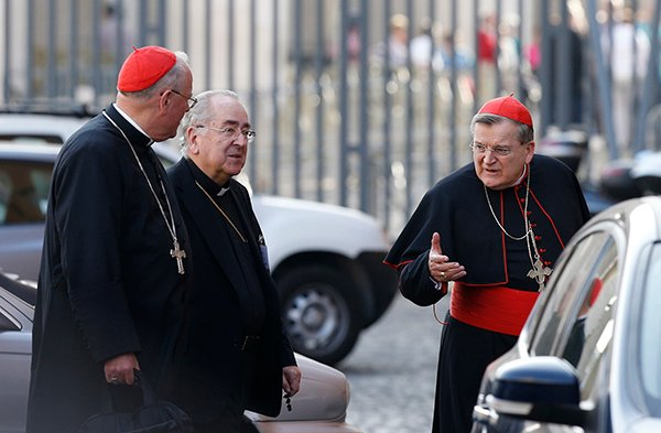 Cardinals Timothy M. Dolan of New York, for right, Stanislaw Rylko, president of the Pontifical Council for the Laity, center, and Raymond L. Burke, prefect of the Supreme Court of the Apostolic Signature, far left, arrive for the morning session of the extraordinary Synod of Bishops on the family at the Vatican on Tuesday (Oct. 14). Photo by Paul Haring, courtesy of Catholic News Service