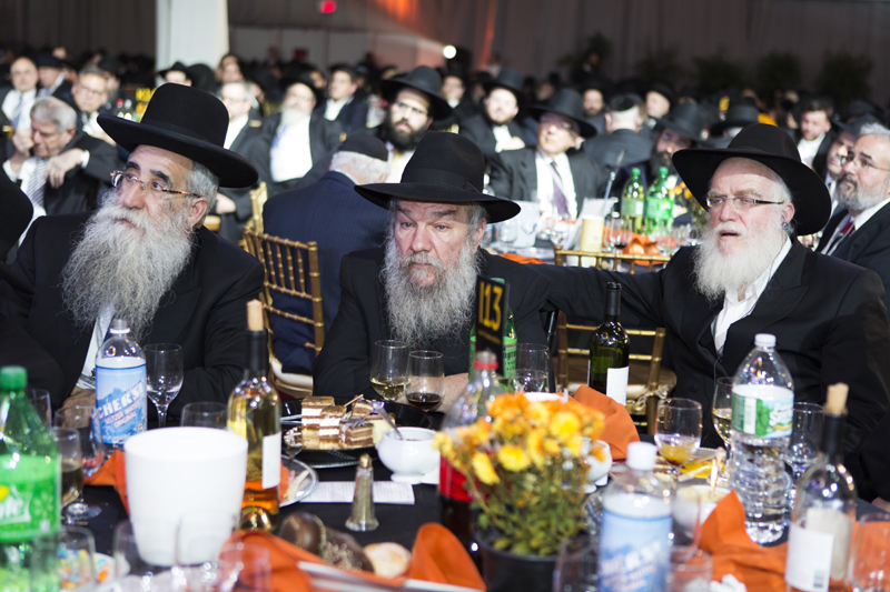 Rabbis are seen in this photo among their colleagues at a banquet at the South Brooklyn Marine Terminal in the Brooklyn borough of New York on November 23, 2014. They are among 5,200 rabbis and guests from over 80 countries in New York for the International Conference of Chabad-Lubavitch Emissaries, an annual event aimed at reviving Jewish awareness and practice around the world. Photo by Adam Ben Cohen / Chabad.org