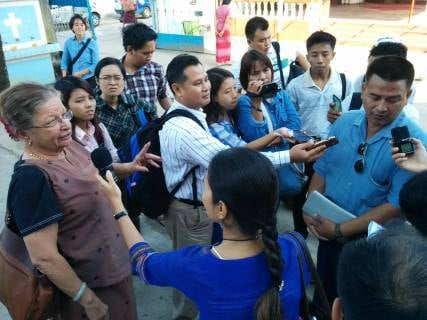 Our trainees form a media scrum outside St. Joseph's Catholic Church during a field trip to Hindu, Buddhist, Christian and Muslim houses of worship in Thingangyun Township, Yangon.