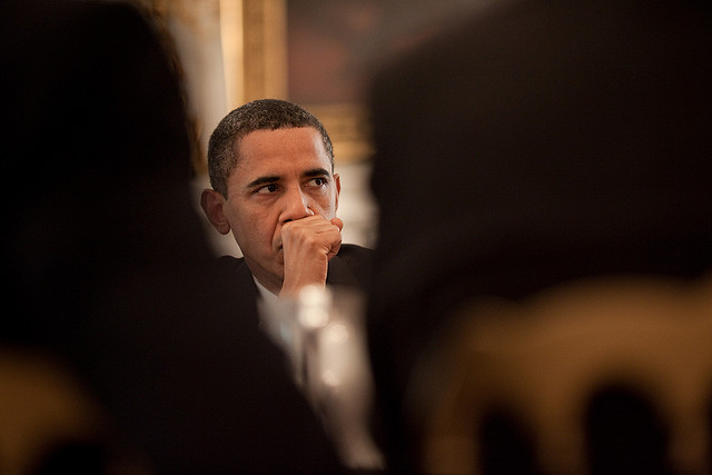 President Barack Obama listens during a meeting with members of Congress for a roundtable discussion about immigration reform on June 25, 2009.