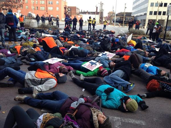 Clergy lay on the ground in Clayton, Mo., the morning after unrest on Nov. 24, 2014 in response to the announcement that Ferguson, Mo., officer Darren Wilson would not be indicted. Photo courtesy of Lilly Fowler