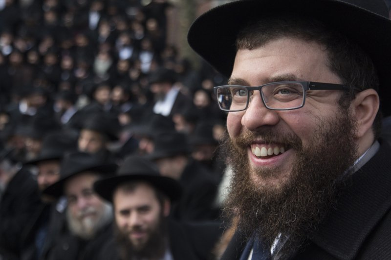 Rabbi Bentzi Sudak, of London, England smiles as he waits to have a group picture taken in front of Chabad-Lubavitch world headquarters in the Brooklyn borough of New York Sunday Nov. 23, 2014. He is among 4,200 rabbis from around the world who are in New York for the International Conference of Chabad-Lubavitch Emissaries, an annual event aimed at reviving Jewish awareness and practice around the world. Photo by Adam Ben Cohen / Chabad.org