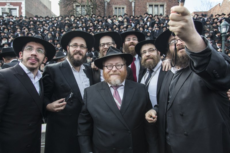 """Rabbis pose for a """"group selfie"""" together with thousands of colleagues in front of Chabad-Lubavitch world headquarters  in the Brooklyn borough of New York, Sunday, Nov. 23, 2014. They are among 4,200 rabbis from around the world who are in New York for the International Conference of Chabad-Lubavitch Emissaries, an annual event aimed at reviving Jewish awareness and practice around the world. Photo by Adam Ben Cohen / Chabad.org"""