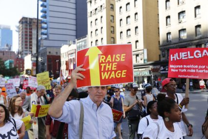 Fast food workers and their supporters marched along 8th Ave in New York City calling for an increase in the minimum wage on Sept. 4, 2014.