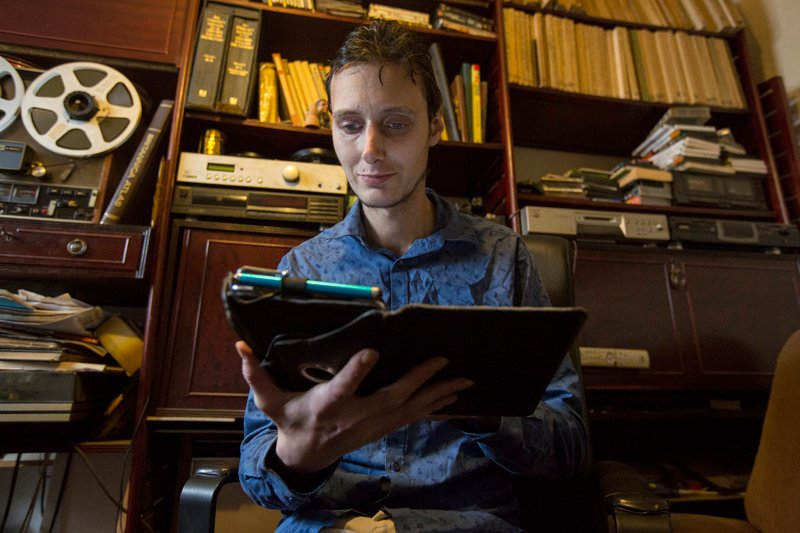 Matt Davies, 33, from Buxton, Derbyshire photographed in his home, where he often posts comments on blogs and religious websites. Religion News Service photo by Alison Baskerville
