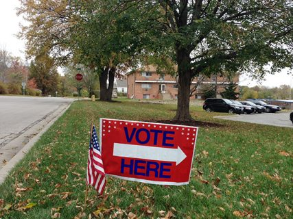 "A ""Vote Here"" sign on display in front of Westwood City Hall on Nov. 4, 2014, in Westwood, Kan. Religion News Service photo by Sally Morrow"