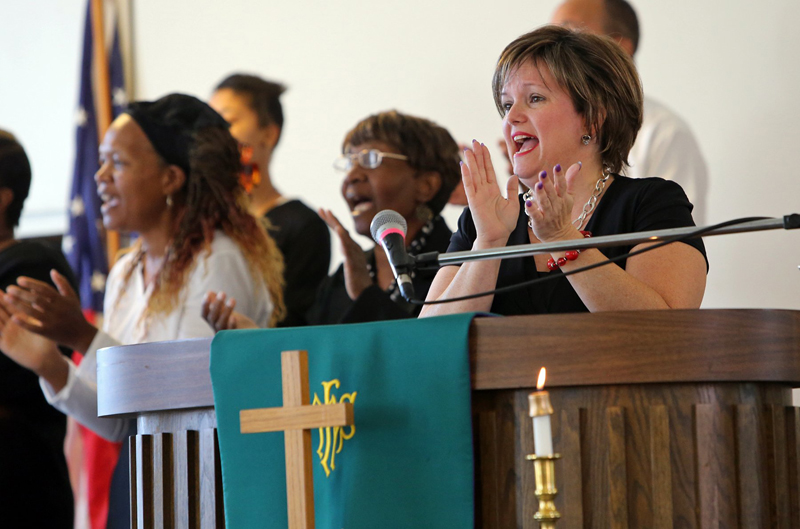 Pastor Renita Lamkin joins the choir in song at St. Johns AME Church on Sunday morning, Oct. 26, 2014, in St. Charles, Mo. Photo by J.B. Forbes, courtesy of St. Louis Post-Dispatch
