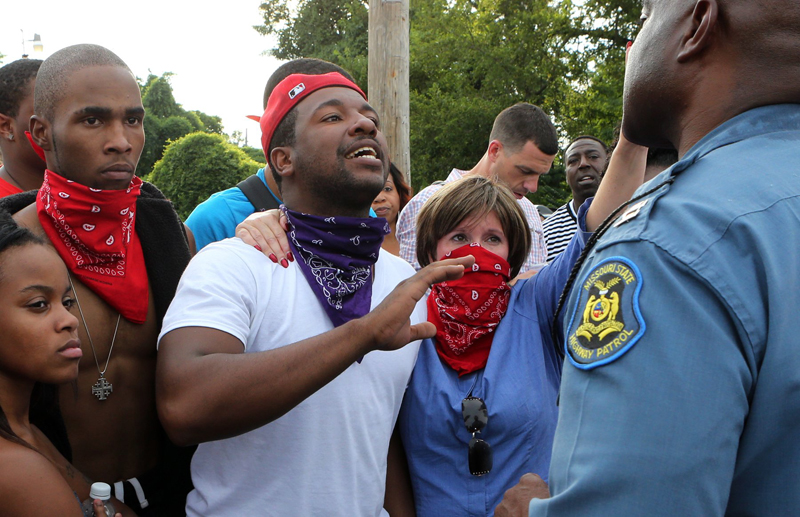 Pastor Renita Lamkin, from St. Johns AME Church, second from right, joins the protesters who confronted Missouri Highway Patrol Col. Ron Johnson in Ferguson on Aug. 14, 2014, with questions about the shooting of Michael Brown. Photo by J.B. Forbes, courtesy of St. Louis Post-Dispatch