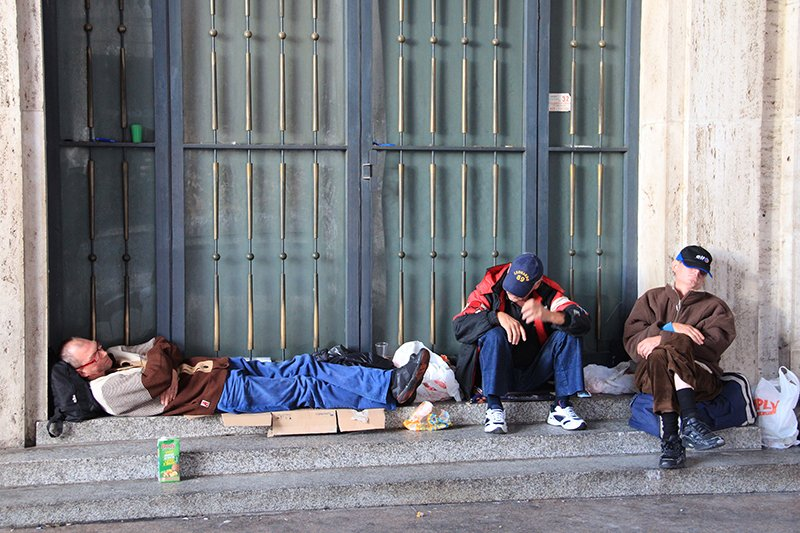 A group of homeless men sleep just outside of St. Peter's Square at the Vatican on Thursday (Nov. 13, 2014). Religion News Service photo by Josephine McKenna