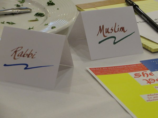 Placeholders at a summit of 60 rabbis and imams at Washington Hebrew Congregation in Washington, D.C. on Sunday (Nov. 23). Organizers hope to replicate the summit at cities across the U.S. in hopes of improving Jewish-Muslim relations, especially in light of continued violence in the Holy Land. Religion News Service photo by Lauren Markoe.