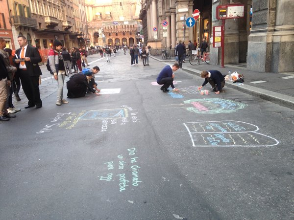 Mormon missionaries draw in the street in Bologna, Italy. Religion News Service photo by Menachem Wecker