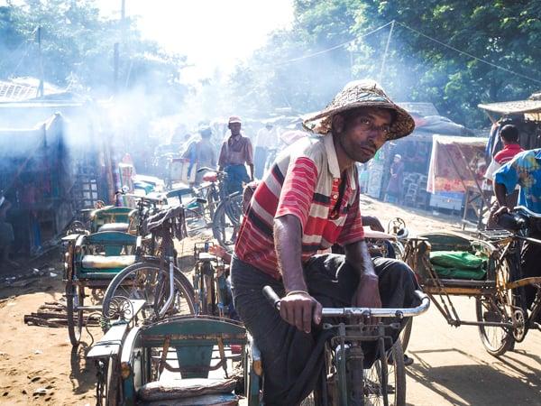 A trishaw driver waits in a Rohingya village near Sittwe, Burma (Myanmar). Photo by Tom Maresca, courtesy of USA Today
