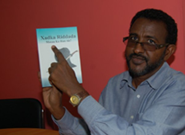 "(RNS) Somali author Abdisaid Abdi Ismail has been threatened with death and labeled an infidel for his book, ""The Rule of Apostasy in Islam, Is it True?"" RNS photo by Fredrick Nzwili."