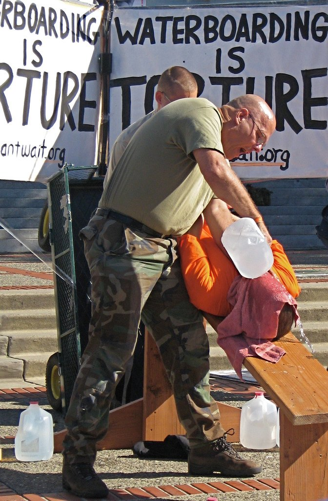 Joe Tougas, US Navy veteran and anti-torture activist undergoes a waterboarding demonstration on the UC Berkeley campus.