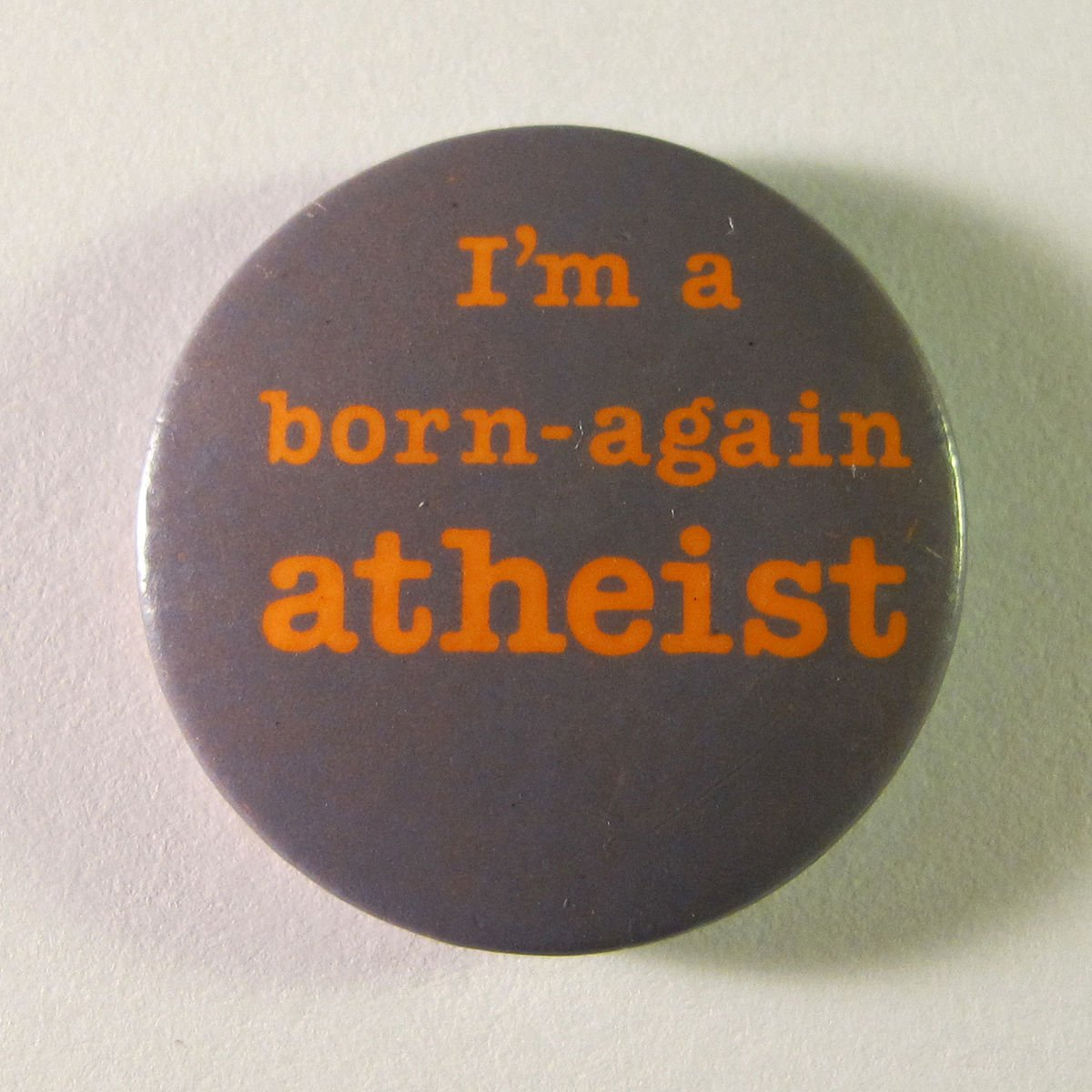 """I'm a born-again atheist"" button. Photo via Wikimedia Commons."