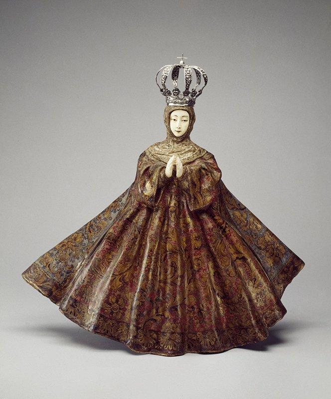 """This sculpture representing the Immaculate Conception reflects the cross-cultural importance of Mary. Its hands and face were carved from ivory in the Philippines and then shipped to the New World, where they were set into the wooden sculpture. Unknown artist, """"Virgin of the Immaculate Conception,"""" 18th century; Philippines and Guatemala; Wood, ivory, pigment, gilding, gessoed cloth, and silver, 25 7/8 x 27 x 10 1/4 in.; Brooklyn Museum, Frank L. Babbott Fund; inv. 42.384. Photo courtesy of National Museum of Women in the Arts"""