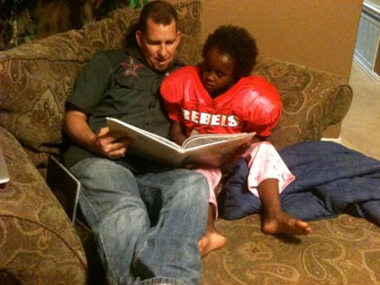 Brandon Hatmaker reads with Ben. Photo courtesy of Jen Hatmaker