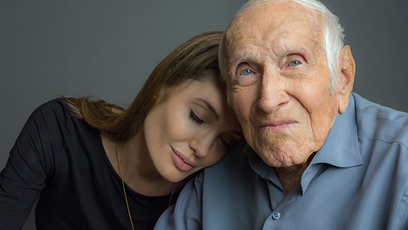 Angelina Joli with Louis Zamperini. Photo courtesy of Universal