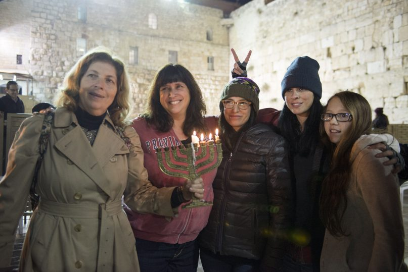More than 100 women, including comedian Sarah Silverman, second from right, participated in the first-ever Hanukkah candle lighting in the women's section of the Western Wall.