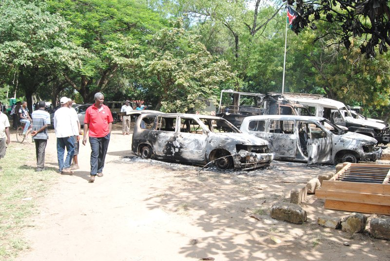 A man walks past burnt cars that were destroyed during a terror attack by suspected Al-Shabaab militants in Mpeketoni area in Lamu county in June 2014. Religion News Service photo by Fredrick Nzwili
