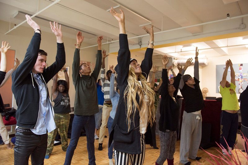 Youth participate in exercises during the Urban Retreat at the Reciprocity Foundation. Reciprocity leads a number of retreats where youth practice yoga and meditation, which aim to help restore an element of spirituality in the young adults she works with. Photo by Alex Fradkin