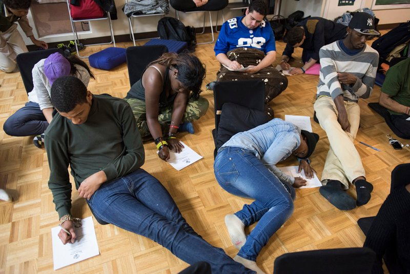 Participants complete a writing exercise expressing hopes, dreams and fears during the Urban Retreat at the Reciprocity Foundation. Photo by Alex Fradkin