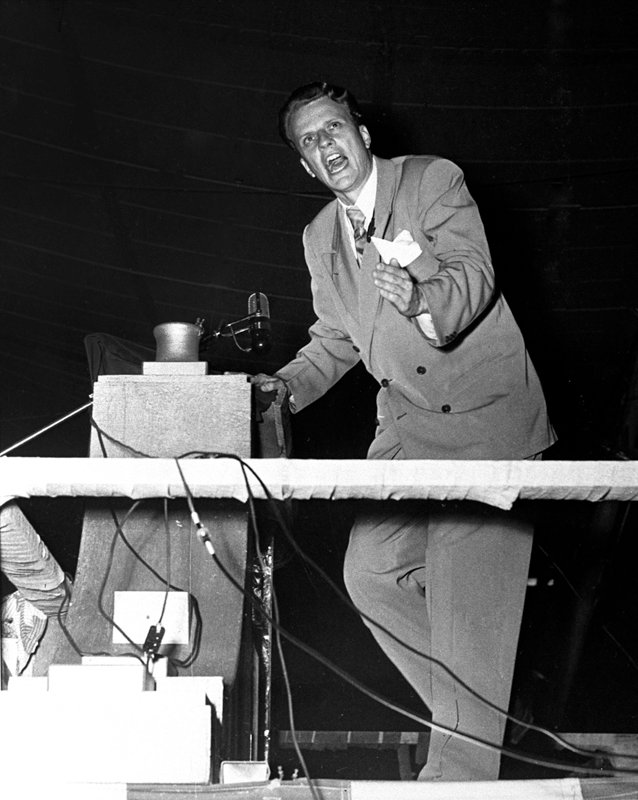 "*ATTN: DO NOT PUBLISH THIS PHOTO!* Billy Graham's fiery preaching and celebrity converts such as war hero Louis Zamperini at the 1949 Los Angeles evangelism campaign, propelled Graham to national attention. Photo courtesy of the Billy Graham Evangelistic Association. *Note to Eds: This photo can ONLY be republished with the story ""RNS-GRAHAM-LA"" written by Cathy Grossman and published on December 9, 2014."