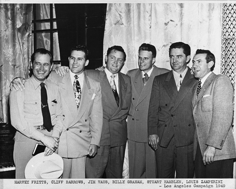 "*ATTN: DO NOT PUBLISH THIS PHOTO!* World War II hero Louis Zamperini (right) and Los Angeles radio celebrity Stuart Hamblen (second from right beside Billy Graham) were two of Billy Graham's most famous converts at his 1949 Los Angeles evangelism campaign. Also show, from left, were Graham's staff members, Harvey Fritts, Cliff Barrows and Jim Vaus. Photo courtesy of Billy Graham Evangelistic Association *Note to Eds: This photo can ONLY be republished with the story ""RNS-GRAHAM-LA"" written by Cathy Grossman and published on December 9, 2014."