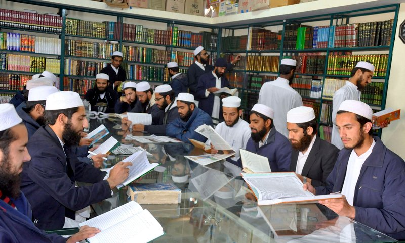 The students of Institute of Islamic Sciences study during a library class. Religion News Service photo by Naveed Ahmad