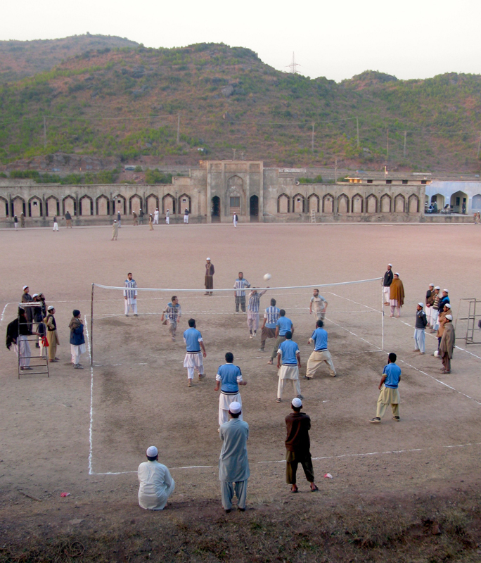 Students and teachers participate in a volleyball game at the Institute of Islamic Science in Islamabad. Religion News Service photo by Naveed Ahmad