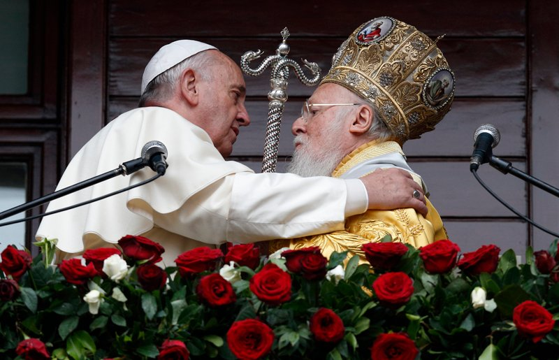 Pope Francis and Ecumenical Patriarch Bartholomew of Constantinople embrace after delivering a blessing in Istanbul on Nov. 30, 2014. Photo by Paul Haring, courtesy of Catholic News Service