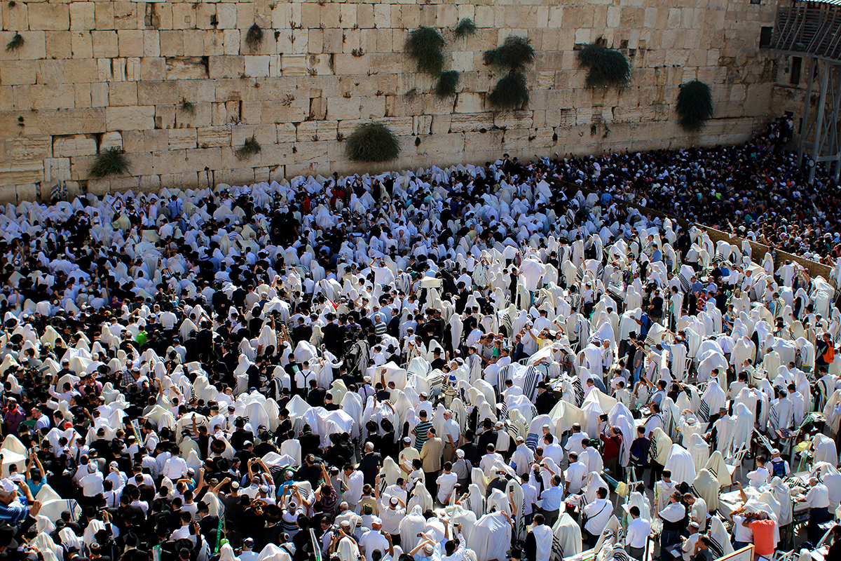 Jewish pilgrims pray before the Wailing Wall in Jerusalem. Photo courtesy of PBS