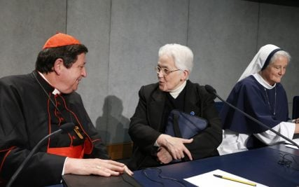 Brazilian Cardinal Joao Braz de Aviz, prefect of the Congregation for Institutes of Consecrated Life and Societies of Apostolic Life, speaks with Sister Sharon Holland, center, president of the Leadership Conference of Women Religious, at the conclusion of a Vatican press conference for release of the final report of a Vatican-ordered investigation of U.S. communities of women religious on Tuesday, December 16, 2014. Also pictured is Sister Agnes Mary Donovan, far right, coordinator of the Council of Major Superiors of Women Religious. Photo by Paul Haring, courtesy of Catholic News Service