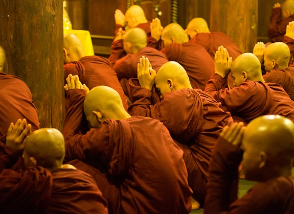 Buddhist monks pray in Mandalay, Myanmar, where government officials have introduced legislation to restrict the marriages of Buddhist women. RNS photo courtesy Shaun Dunphy/Flickr.