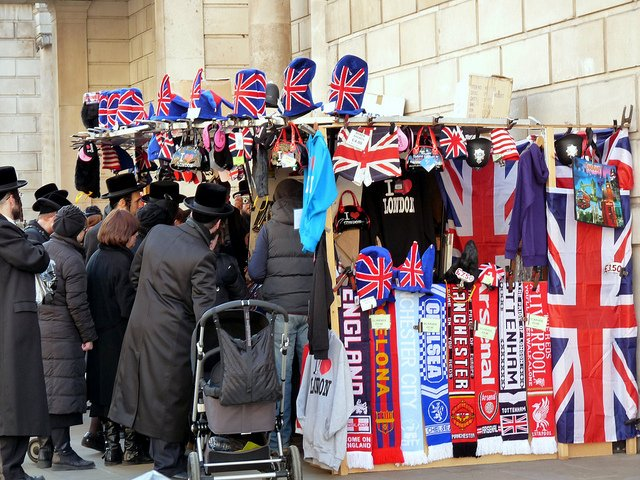 A group of Hasidic Jews enjoying a London souvenir stand near 10 Downing Street in Westminster.