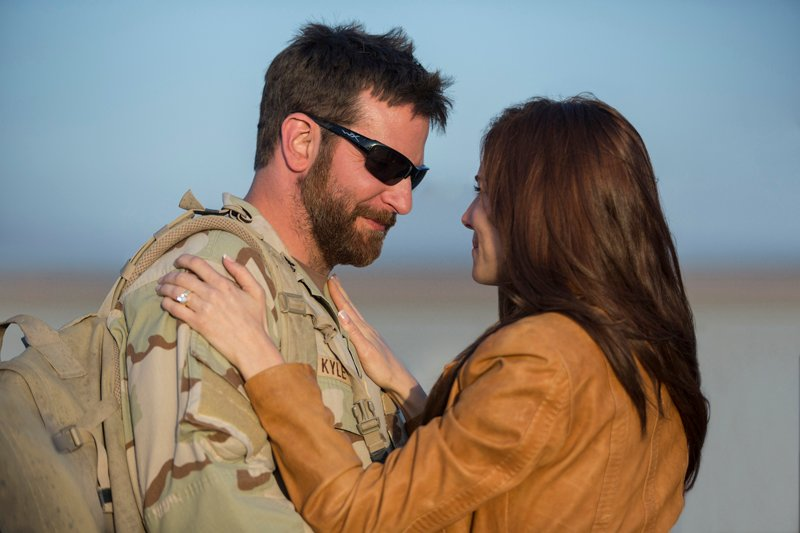 "Bradley Cooper as Chris Kyle and Sienna Miller as Taya in Warner Bros. Pictures' and Village Roadshow Pictures' drama ""American Sniper."" Photo courtesy of Warner Bros. Pictures"