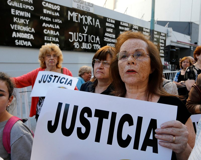 "People holding signs that read ""Justice"" gather outside the Jewish community centre AMIA to demand justice and a full investigation over the death of Argentine prosecutor Alberto Nisman, in Buenos Aires on Wednesday (January 21, 2015). Photo courtesy of REUTERS/Enrique Marcarian *Note: This photo may only be republished with RNS-ARGENTINA-JEWISH, published on January 22, 2015"