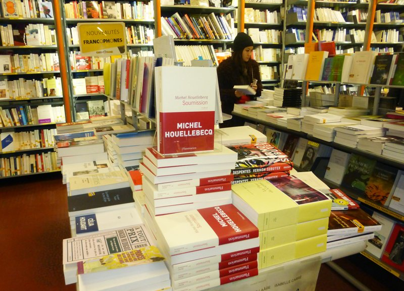 """Michel Houellebecq's book """"Soumission"""" seen on display in Gilbert Jeune bookstore in Paris. Hours after the first copies of Submission appeared in bookstores, assailants stormed the office of Charlie Hebdo, gunning down a dozen people and unleashing a three-day bloodbath. Religion News Service photo by Elizabeth Bryant"""