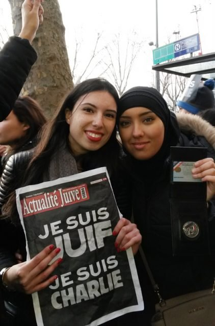 High school student Amina Tadjouri, right, with a friend at Place de la Republique in Paris during a demonstration Sunday (January 11, 2014). Religion News Service photo by Elizabeth Bryant