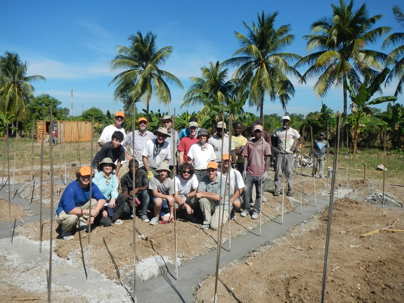 Adat Shalom volunteers with Haitian partners finish pouring the foundation for the first house at Lambi Village 2, designed to house 60 Haitian families through Grace International Ministries. Photo courtesy of Adat Shalom Reconstructionist Congregation, Bethesda, MD