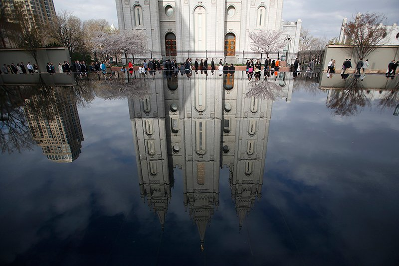 People walk past Salt Lake temple as they arrive to attend the biannual general conference of the Church of Jesus Christ of Latter-day Saints in Salt Lake City, Utah on April 5, 2014. Photo courtesy of REUTERS/Jim Urquhart *Note: This photo may only be republished with RNS-MORMON-GAYS, originally published on January 27, 2015 or RNS-TRANS-MORMONS, originally published on April 1, 2015, or with RNS-PARLIAMENT-RELIGIONS, originally transmitted on Oct. 14, 2015.